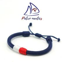 Sötétkék állítható vitorlás karkötő fehér - piros átkötéssel
