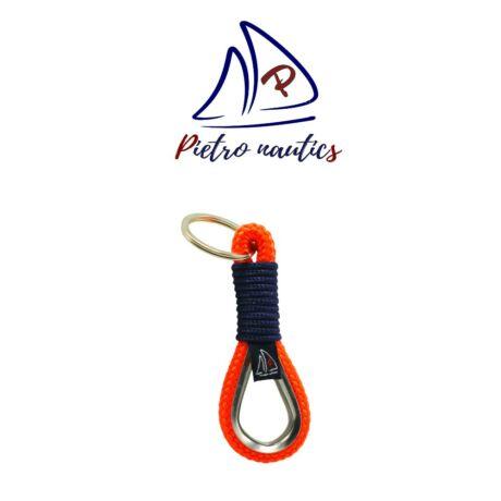 Neon narancs kulcstartó sötétkék átkötéssel, kötélszívvel